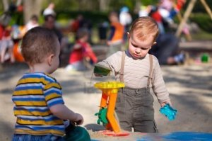 1414282-2-years-old-children-are-playing-together-in-the-sandbox